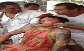 Thai festival man mouth impaled with metal spikes 12