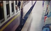 India – a man trying to get off the train in motion