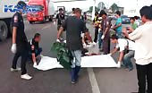 Aftermath of a biker goes under 18 wheeler truck