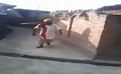 Man walks around village with impaled garden hoe 9