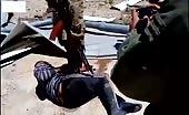 Russians torturing prisoner with sledge hammer