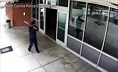Crazy guy with bat at police station 15