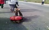 African motorbike thief dealt with mob justice