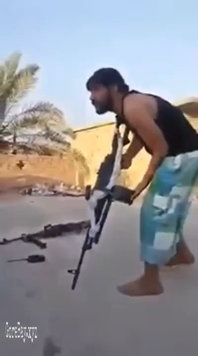 Guy with a machine gun got sniped while showing off