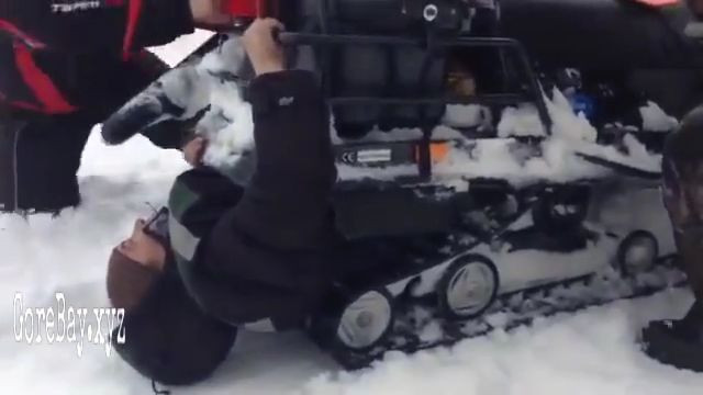 A man unharmed after being sucked into a snowmobile