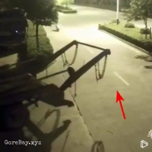 Biker rides into chain attached to a reversing truck