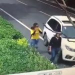 Crazy driver runs over a woman after the woman throws dirt on windscreen 2