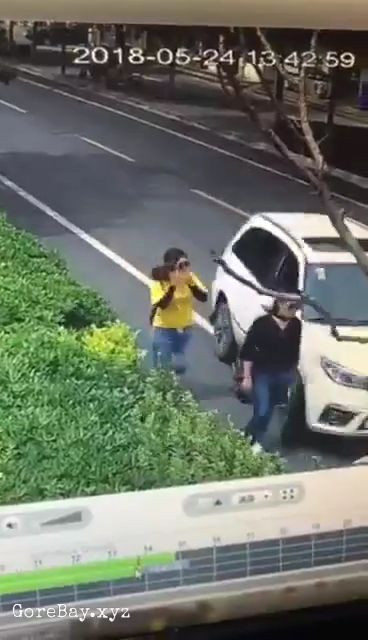 Crazy driver runs over a woman after the woman throws dirt on windscreen