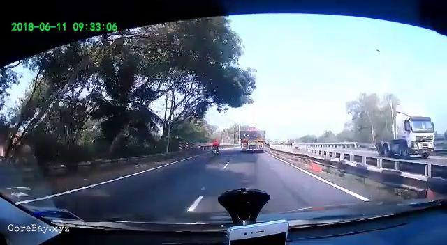 Tire separated from a speeding truck slamming a biker