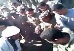 Public and militia tortures one of the civilians 2