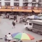 Human Pinball - Woman pushed by a truck to under another truck 3