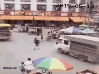 Human Pinball – Woman pushed by a truck to under another truck