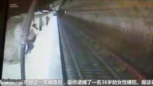Woman pushes another woman onto train track as the train arriving