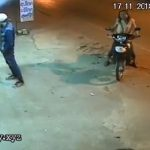 Cold blooded robber swings a machete to the head of a woman 2