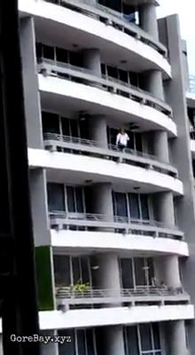 Woman falls from balcony after trying to take a selfie