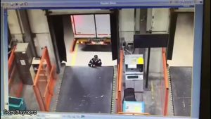 Man standing in front of loading dock crushed by a reversing truck