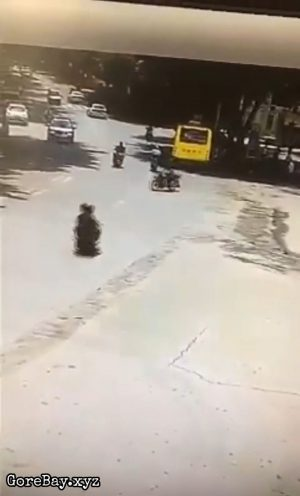 Scooter bumps into a bike and slams a bus
