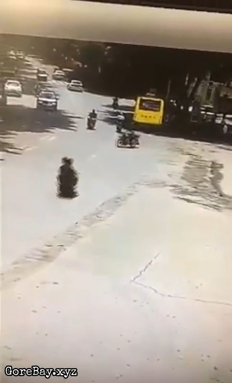 Scooter bumps into a bike and slams a bus 5