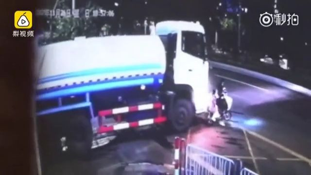Little girl sitting on the back of a scooter is crushed by a truck 2