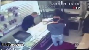 Robber shoots a jewelry employee with a shotgun