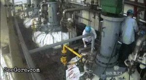 Industrial worker sent flying in pieces by a burst from reactor