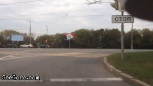 Biker slides, bumps the curb, then bounces