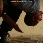 ISIS slit the throat of a man hanging upside down 2