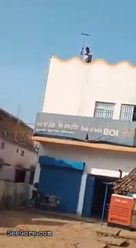 Indian youth jumps from bank roof to the ground