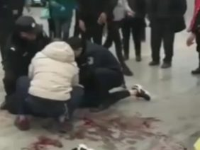 A China guy gets his neck slashed