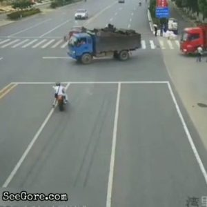 Biker go straight for a truck and burns down