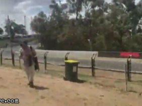 Racing car slides and crashes at a track corner