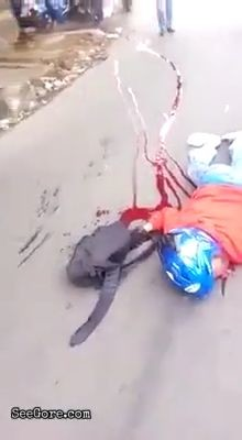 Biker left dying on a busy road