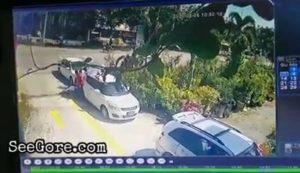 Biker sent flying after crashing into a car