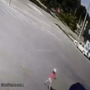 Car slowly rolls on a kid