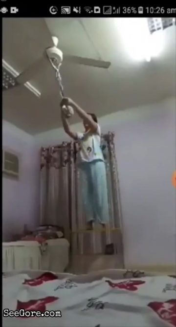 Woman dies slowly by the rope she is hanging to 10