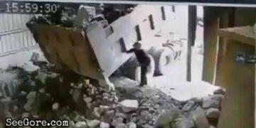 Big boulder falls onto a man 26