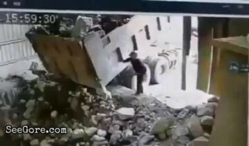 Big boulder falls onto a man 6