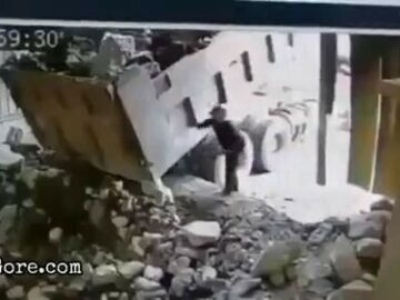 Big boulder falls onto a man 7