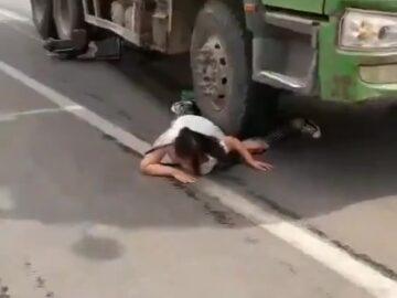 Woman stuck under a truck wheel 5