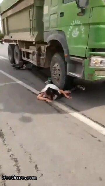 Woman stuck under a truck wheel 18