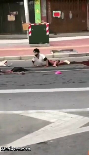 Horribly injured man tries to reach for his dead partner 1